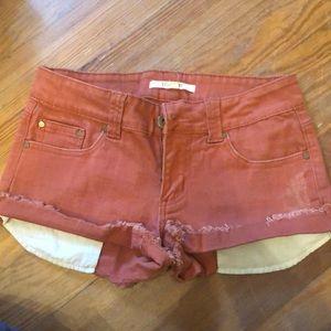 Burnt orange denim shorts